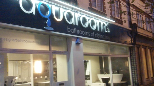 aquarooms shop front by night